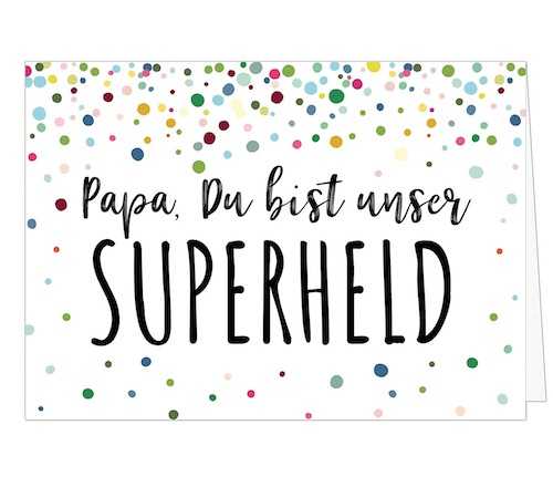 """Große Klappkarte mit weißem Untergrund, punkten Konfetti-Punkten und dem Schriftzug """"Papa, Du bist unser Superheld"""" im Handlettering-Style"""